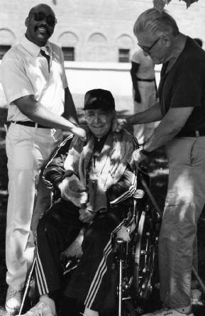 17. Russell Bufalino (in wheelchair) getting a friendly knockout punch from Sheeran, circa 1986.