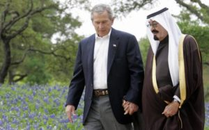 14. Bush and late Saudi King Abdullah hand in hand